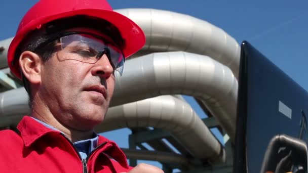 Engineer Inside Oil and Gas Refinery Using Laptop