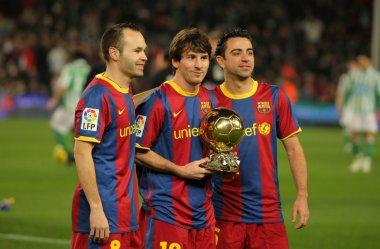 Iniesta, Messi and Xavi of Barcelona
