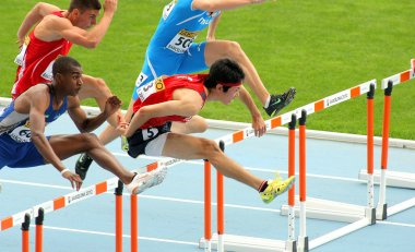 Shunya Takayama(R) of Japan during 110m men hurdles event