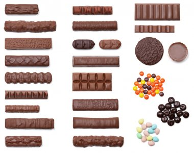 A collection of 25 chocolate candies shot from an overhead view isolated on white. stock vector