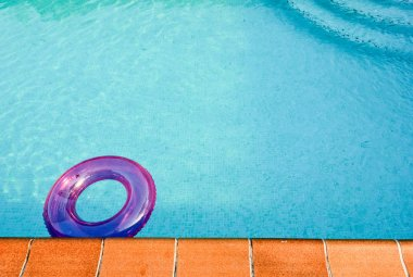 Purple tube in a turquoise swimming pool