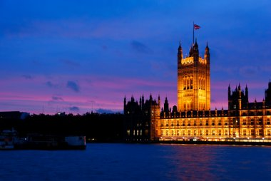 Illuminated Houses of Parliament at dusk