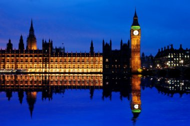 Houses of Parliament at dusk and their reflection in the Thames