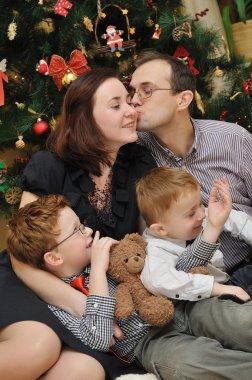 Family near the Christmas-tree