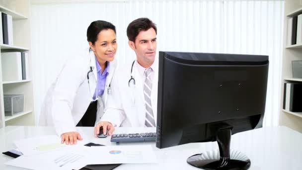 Hispanic Doctors Using Computer