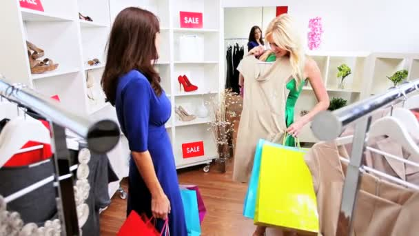 Female Friends Browsing Exclusive Clothing Store