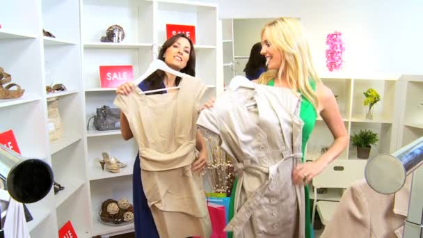 3b642d89c4d57 Female Friends Browsing Exclusive Clothing Store — Stock Video ...