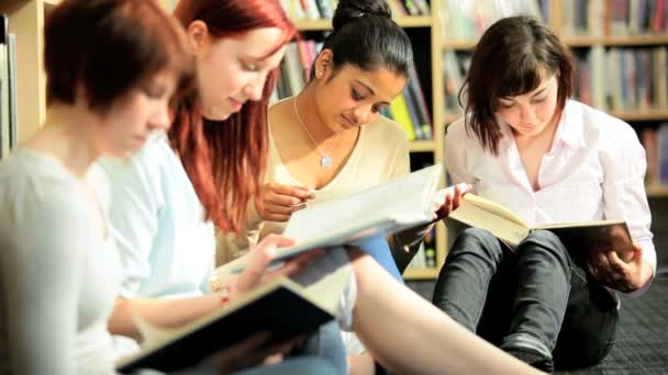Female students researching knowledge on books