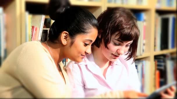 Diverse classmates study on tablet