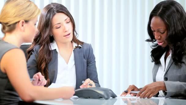 Businesswoman managing multi ethnic female colleagues