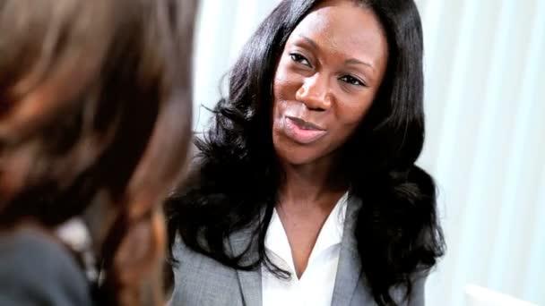 Ethnic businesswomen discussing management strategy