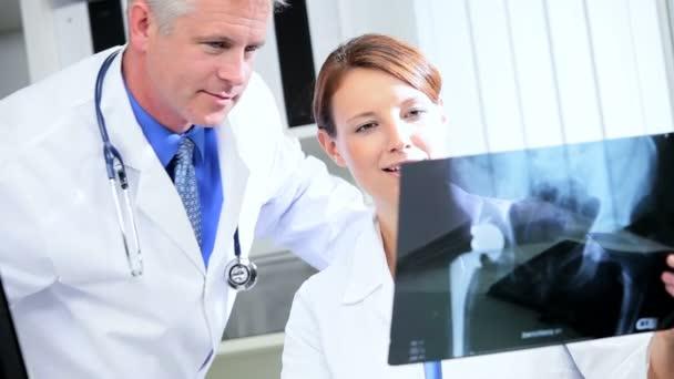 Radiologist Examining X-Ray Film