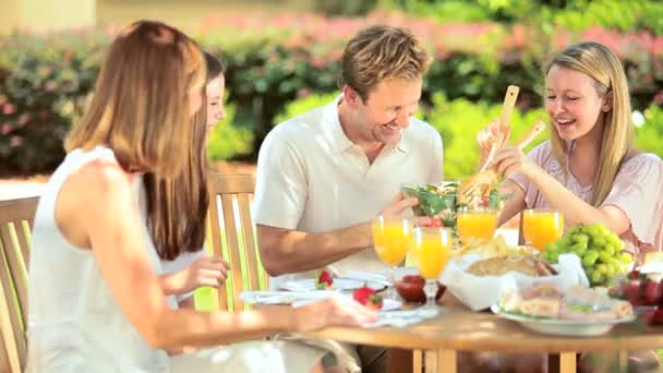 Caucasian parents eating with daughters healthy lunch