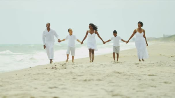 Happy ethnic family summer walking together by ocean