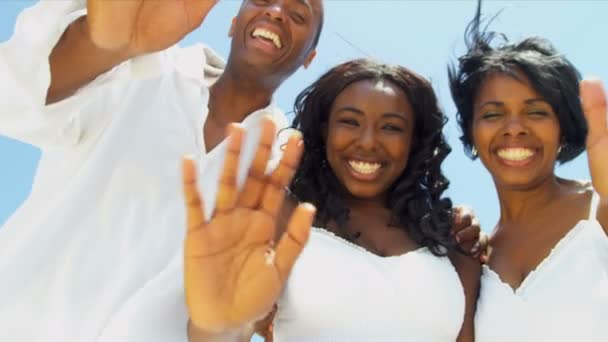Smiling African American family have fun together on beach