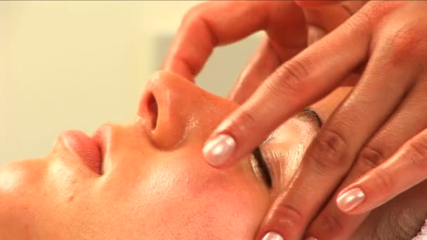 Beautiful blonde girl having facial massage