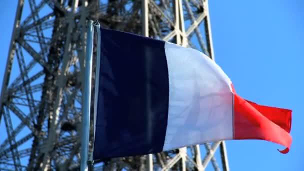 French national flag in front of Eiffel Tower