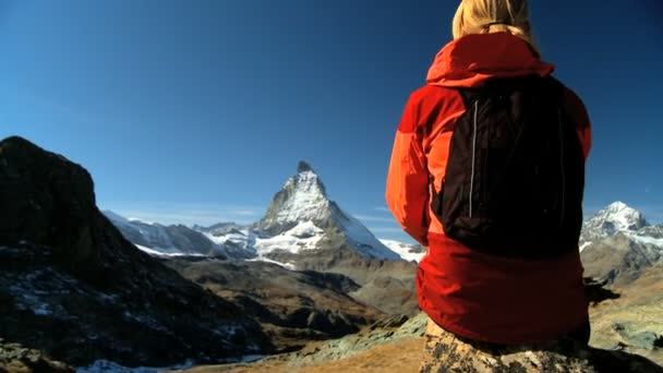 Female hiker enjoying view of the Matterhorn