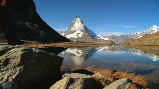 Female hiker in beautiful alpine landscape with lake  Matterhorn peak