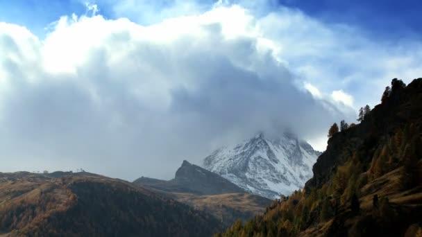 Time-lapse clouds over the Matterhorn  alpine meadow in Zermatt
