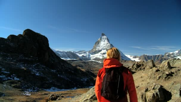 Female hiker enjoying view of the Matterhorn