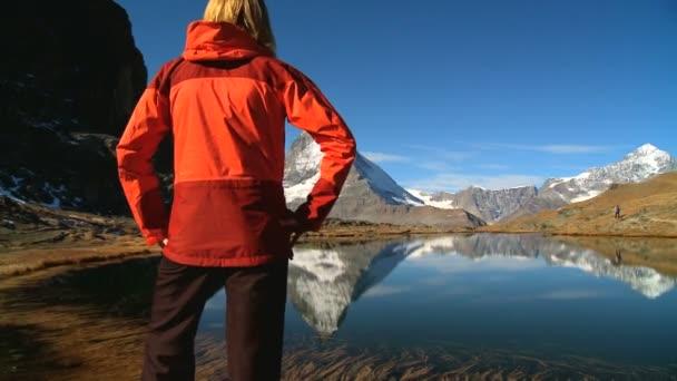 Female hiker in beautiful alpine landscape with lake  Matterhorn peak