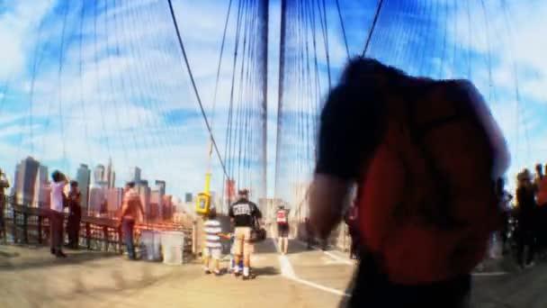 Time-lapse with Fish-eye view of pedestrians  Manhattan skyline on Brooklyn Bridge