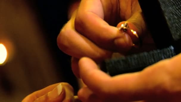 Young man displaying a diamond ring in his marriage proposal in close-up