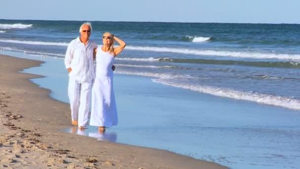 Seniors Barefoot on the Beach