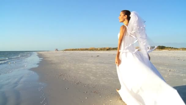 Bride in Wedding Dress on Beach