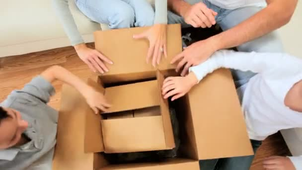 Caucasian Family Searching Boxes for Childs Toy