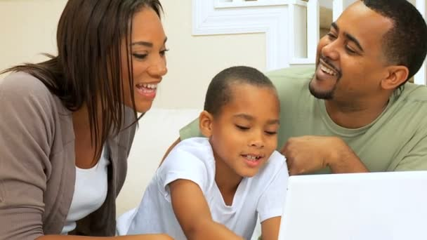 African American Family Viewing a Laptop