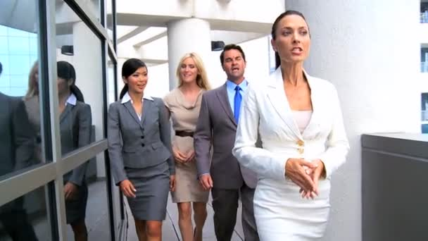 Female Business Executives Leading Team to a Meeting