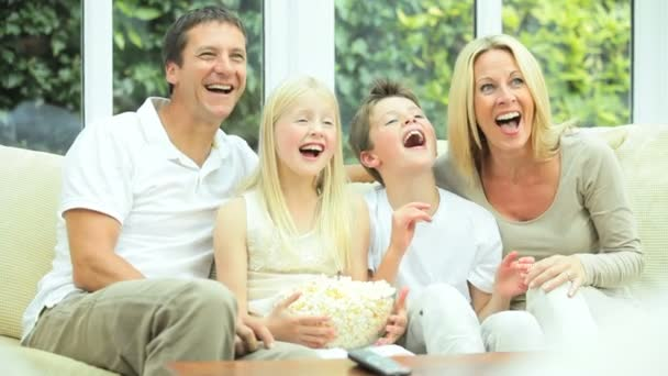 Young Family Watching Movie Together with Popcorn