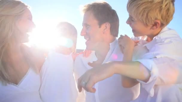 Happy Young Family Together at the Beach