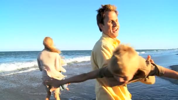 Caucasian Parents Playing with Their Children on Beach