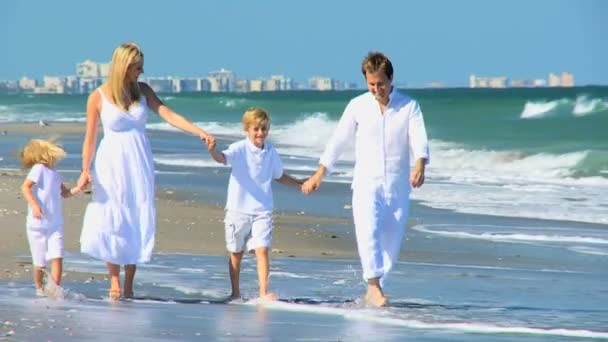 Young Caucasian Family Walking Beach Together