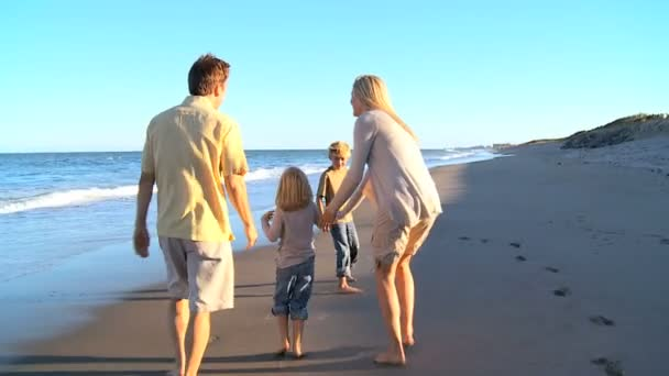 Young Caucasian Family Beach Fun