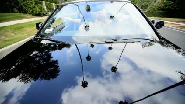 Caucasian Girls Driving Luxury car
