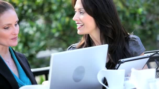 Female Business Executives Meeting Outdoors