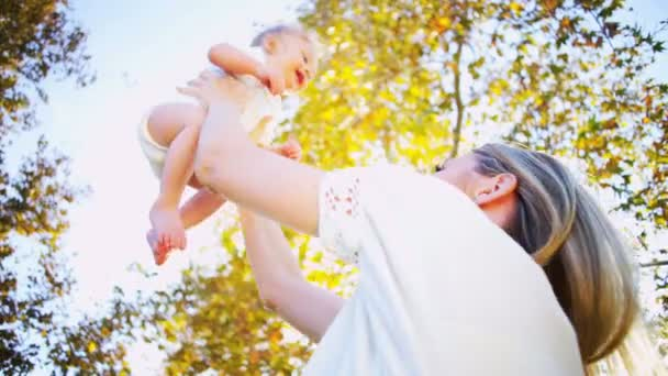 Caucasian Mother and Baby Laughing Together
