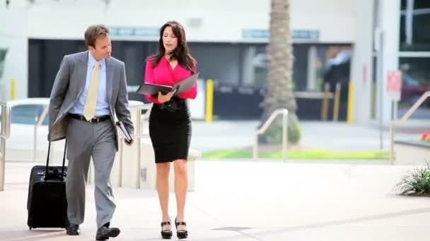 Secretary Meeting Businessman from Business Trip