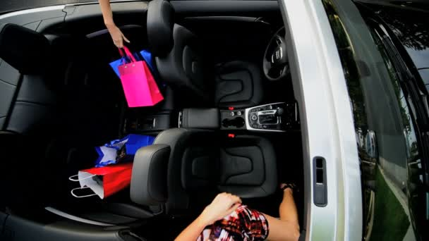 Overhead Girlfriends Luxury Car Retail Therapy