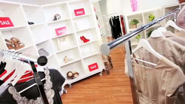 African American Female Shopping in Designer Store