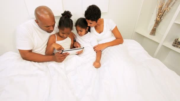 Ethnic Couple Children Using Wireless Tablet Bed