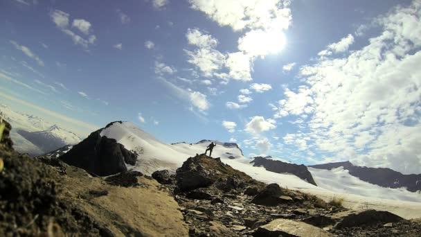Lone triumphant climber
