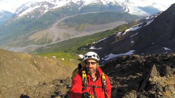 Peak Climber filming panorama
