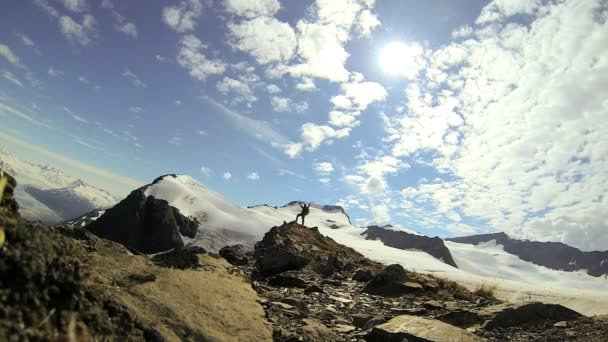 Climber in summer enjoying his success