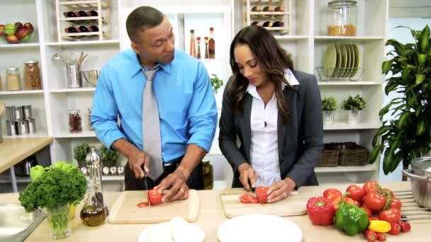 Business couple in the kitchen preparing