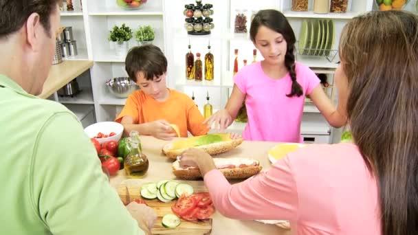 Family preparing healthy crusty baguette
